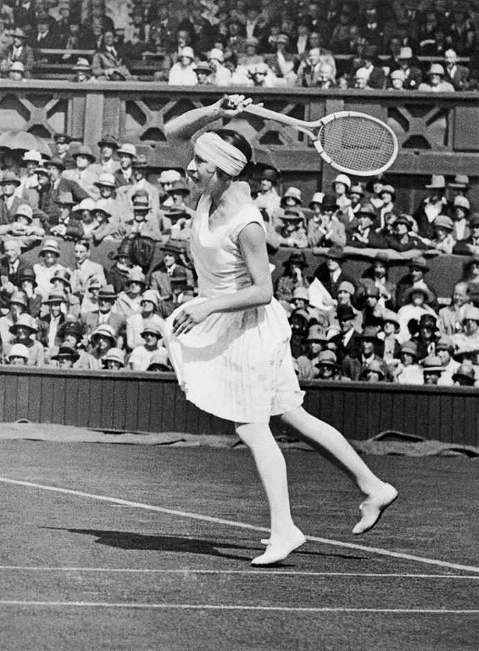 **Suzanne Lenglen, Wimbledon 1930**  <br><br> Suzanne is an original revolutionary when it comes to on-court fashion. Raising the hem of her skirt, she was one of the first to embrace practicality and function over tradition.