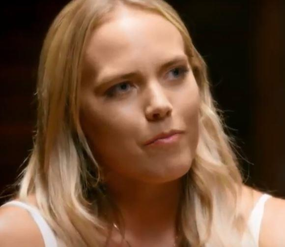 Cass is visibly uncomfortable during a 'human lie detector' interrogation.