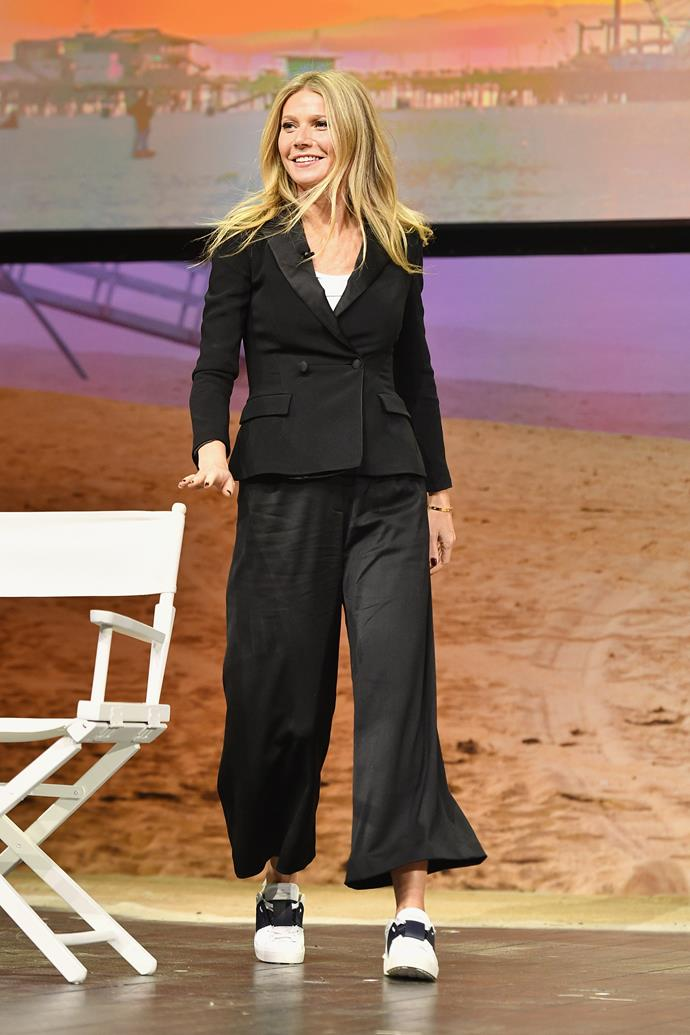 **Gwyneth Paltrow** <br><br> Pairing trainers with this flared-leg pantsuit is a left-of-field choice for this mum-of-two, but the actress pulls it off.