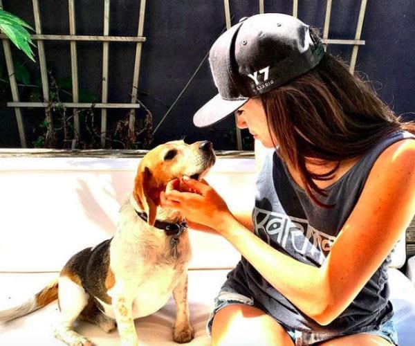 Meghan and her rescue beagle, Guy.