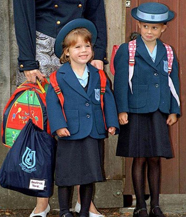 "The stark contrast between Eugenie and big sister Beatrice's faces in [this pic](https://www.nowtolove.com.au/royals/british-royal-family/princess-eugenie-throwback-picture-beatrice-51082|target=""_blank"") is hilarious enough, but Eugenie's caption sums it up: ""Throwback to school days. Clearly I was more excited than Beatrice!"". *Image: Instagram/[@princesseugenie](https://www.instagram.com/princesseugenie/