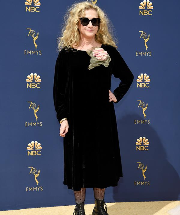 Carol Kane adds some quirky accessories to her look.
