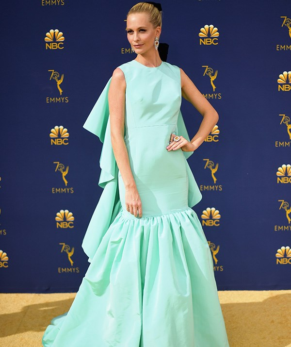 British model Poppy Delevingne stands out in this Tiffany-blue gown.