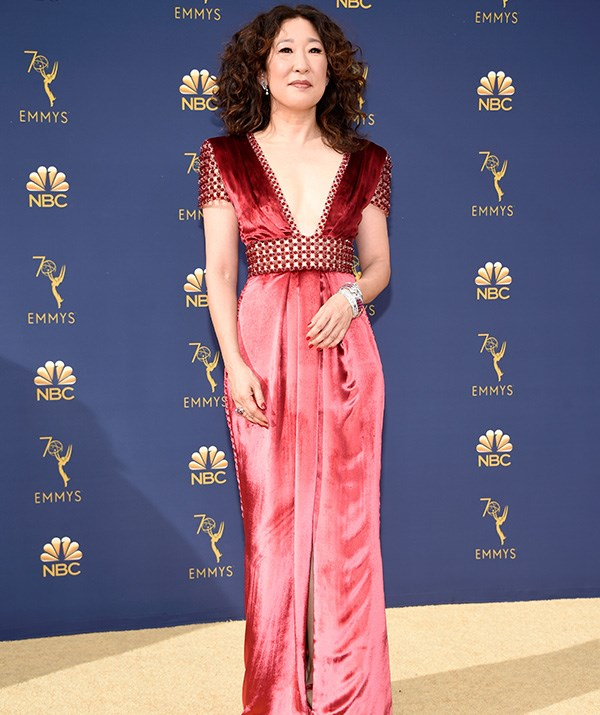 At 47-years-old, Sandra Oh never fails to stun us with her youthful beauty. We love the ruby red satin!