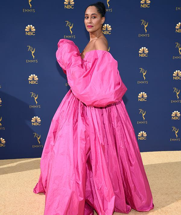 Talk about making a statement! Tracee Ellis Ross goes for a daring Valentino Haute Couture fuchsia puff-sleeve dress.