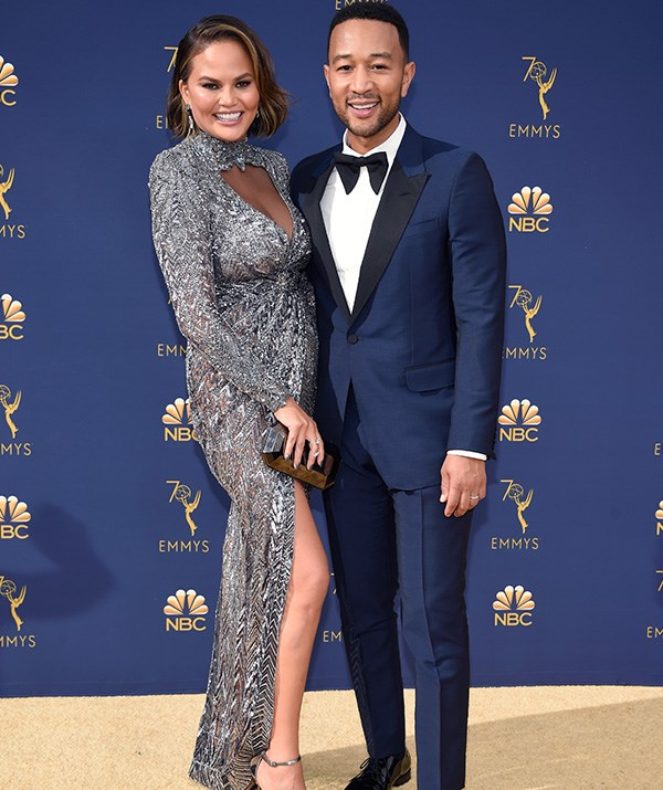 Proud parents John Legend and Chrissy Teigen look as glam as ever.