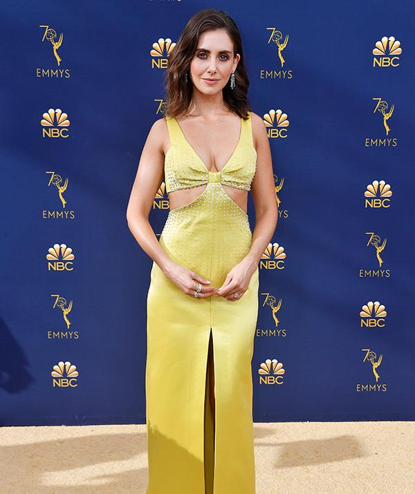 *Glow* star Alison Brie charms in this yellow cut-out gown. That's a daring split up the front though!