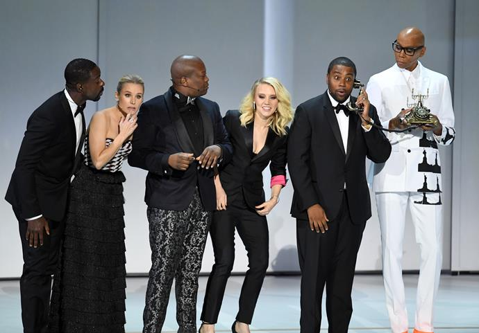 Sterling K Brown, Kristen Bell, Titus Burgess, Kate McKinnon, Kenan Thompson and Ru Paul onstage at the 2018 Emmy awards.