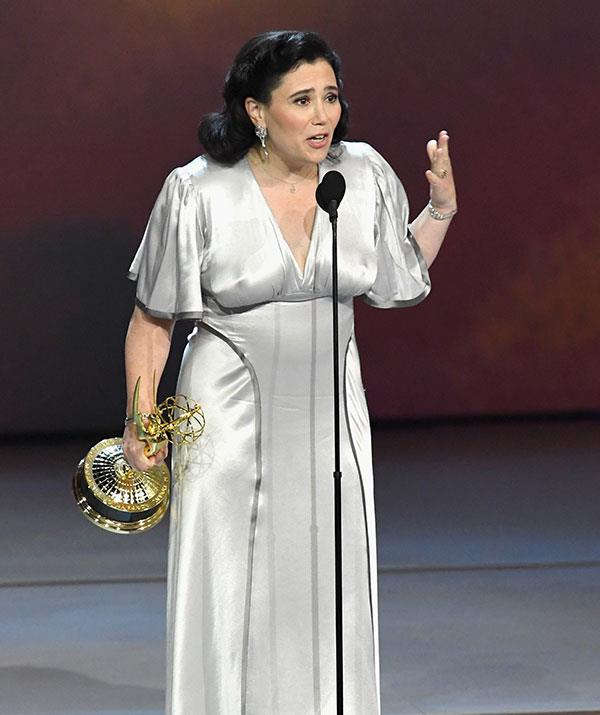 *The Marvelous Mrs. Maisel* star Alex Borstein collects her award for Best Supporting Actress in a Comedy Series at the 2018 Emmys.