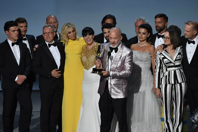 The cast and crew of *The Assassination of Gianni Versace: American Crime Story* are all smiles as they accept the Outstanding Limited Series award.