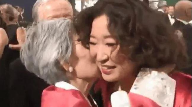 "Sandra's mum, Jeon Young-nam told the reporter she was ""very proud"" before planting a big kiss on her daughter."
