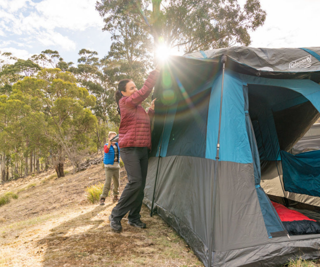 Encourage your children to help set up the campsite for extra fun.