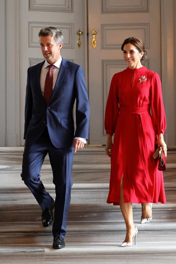 **August 2018, Copenhagen** <br><br> From board shorts to this stunning red dress, there's no denying it: Princess Mary has officially nailed royal style.