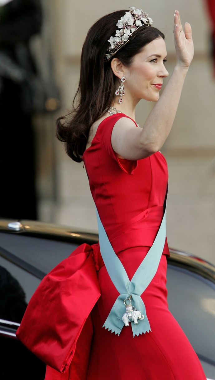 **May 2004, Copenhagen** <br><br> Crown Princess Mary, who was weeks out from her wedding at this stage, absolutely stunned in this ravishing red ensemble.