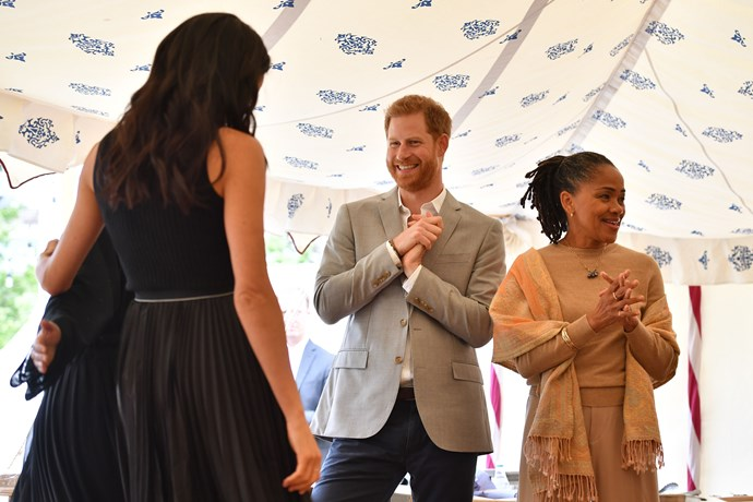Harry and Doria watched on proudly as Meghan spoke to the women who had been affected by the Grenfell Tower tragedy.