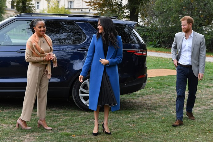 The royal trio were all smiles at the event.