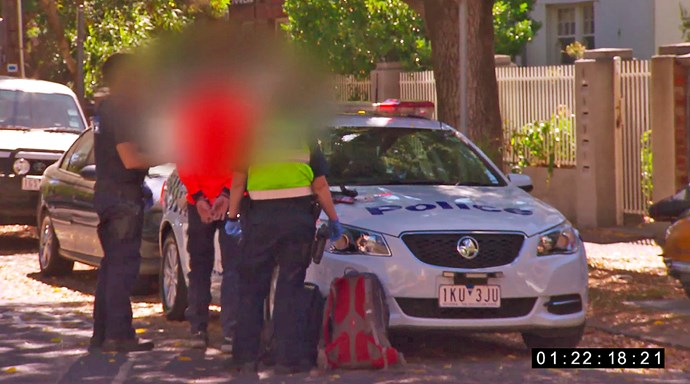 A tradie leaves *The Block* in handcuffs.