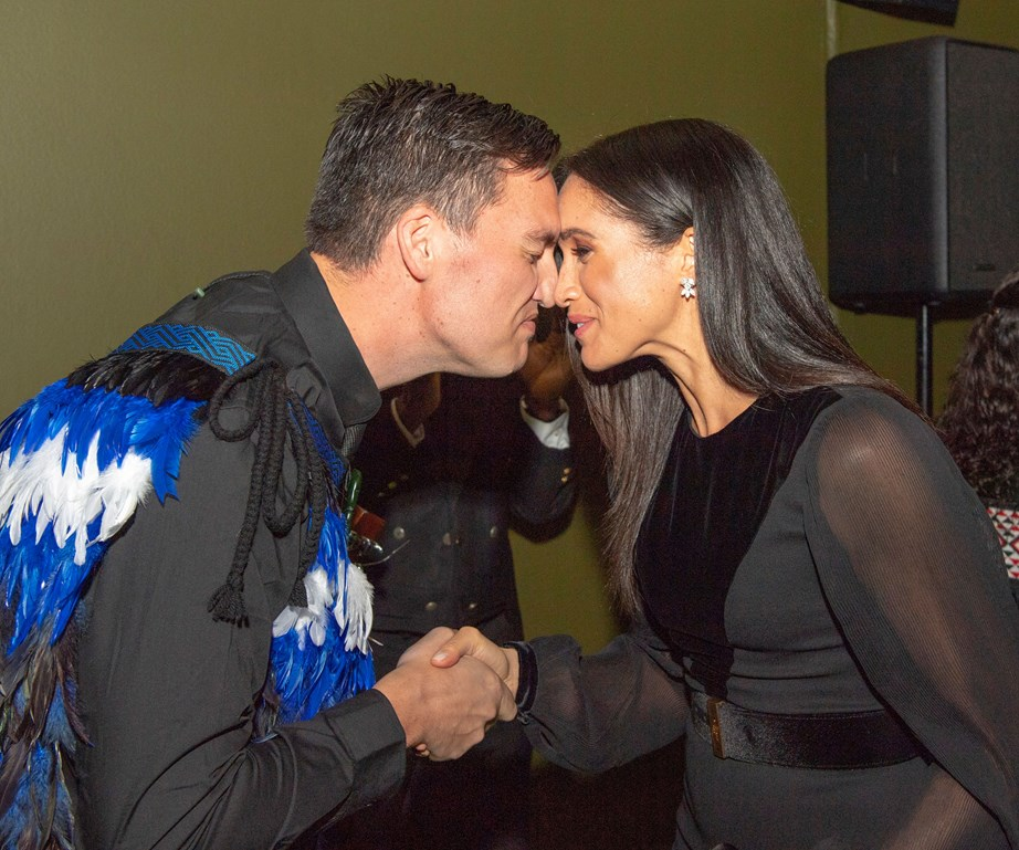 Meghan Markle taking part in a traditional hongi.