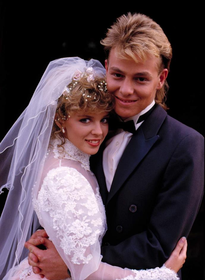 **SCOTT & CHARLENE (1986-1989)**  **This teenage love story captured hearts across the world.**  Boy-next-door Scott Robinson (Jason Donovan) and tomboy Charlene Mitchell (Kylie Minogue) were together both on screen and off. Fans here and in the UK couldn't get enough of their wholesome love. In the UK, 20 million viewers tuned in for their nuptials. Sadly, Scott and Charlene left Ramsay Street, but their kids, Daniel (Tim Phillipps) and Madison (Sarah Ellen), have both popped up in Erinsborough.