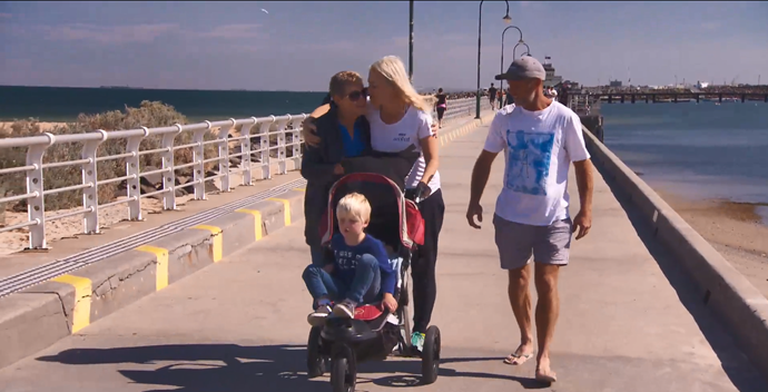 Jess takes a stroll with her mum, hubby Norm and son Freddie, four.