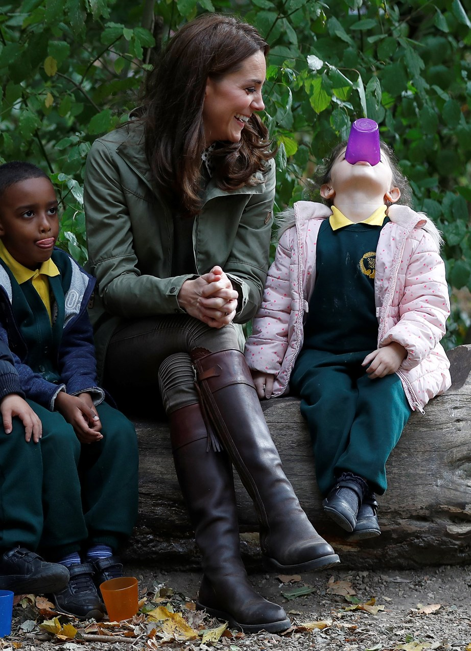 Duchess Catherine jumped right back into her royal duties, laughing and chatting to young children at a visit to a forest and garden school.