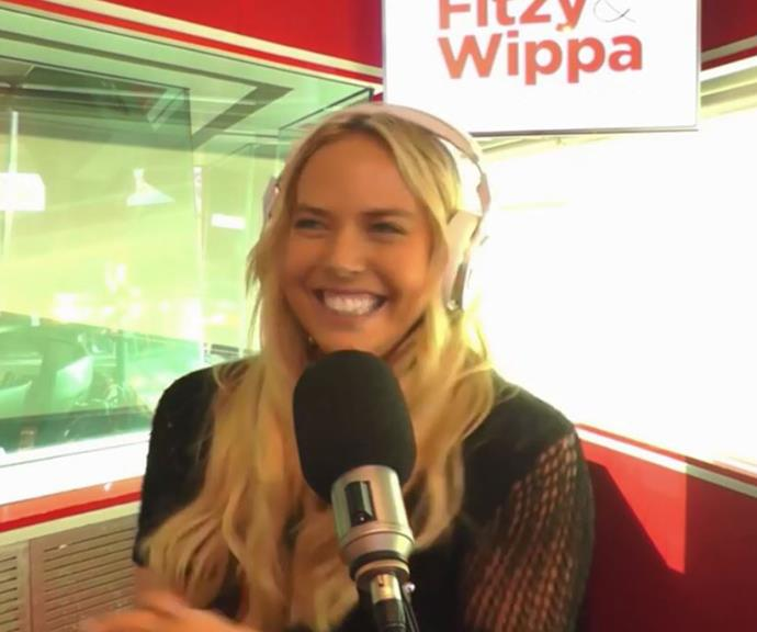 Cass's smile was *very* telling during an interview with *Fitzy and Wippa*.