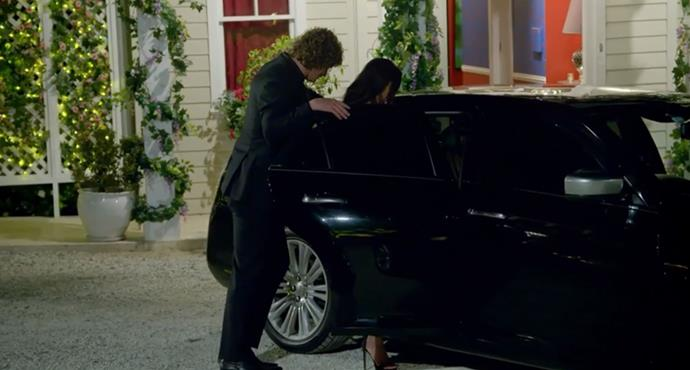 Nick helps Brooke into the car as she exits the mansion...