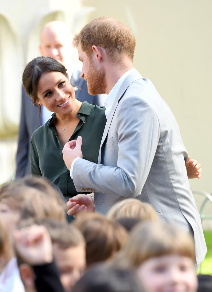 Duchess Meghan and Prince Harry were seen laughing and holding hands throughout the visit.