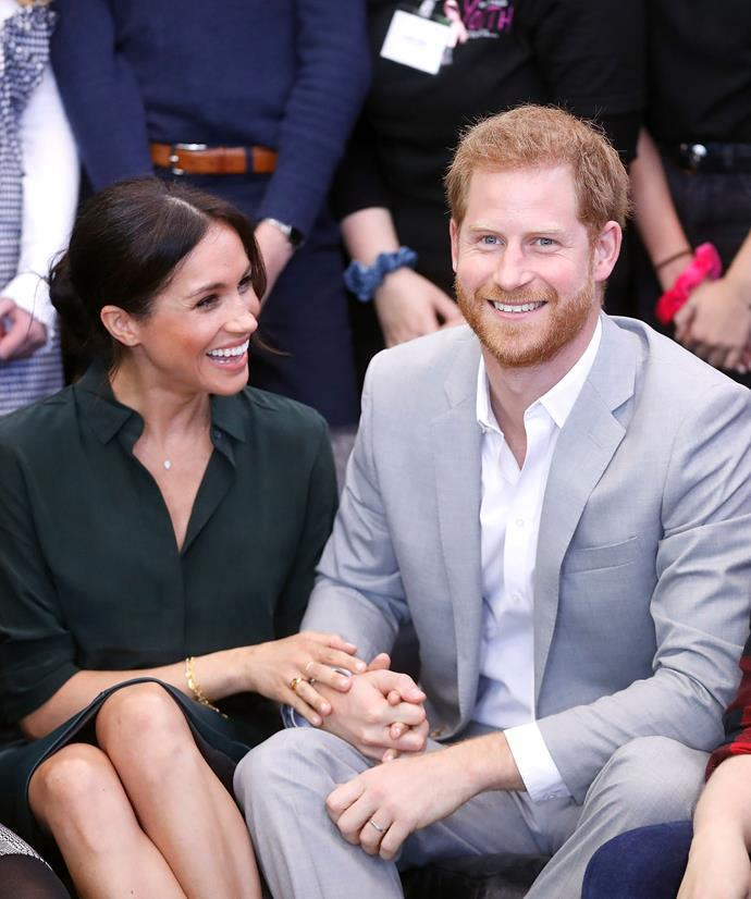 Harry and Meghan laughed and held hands throughout the visits.