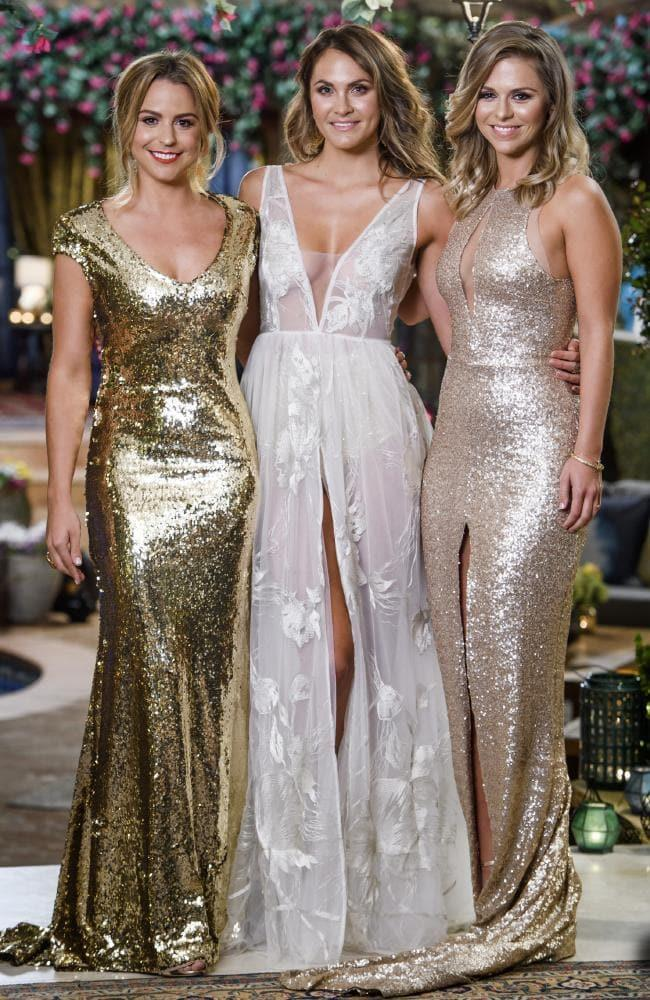 2017: Laura Byrne wears a white dress, while Tara and Elise are stunning in gold gowns.