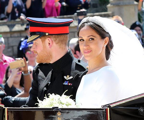 Fans were ecstatic to greet the newlyweds as they made their way through the streets of Windsor on a horse-drawn carriage following the ceremony.