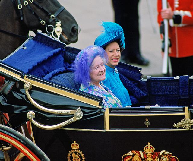 The Queen Mother and Princess Margaret also came by carriage. Their bold shades of blue and feathered headpieces are a sign of the daring fashions to come.