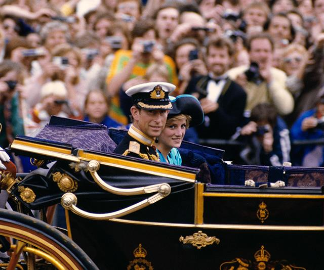 Prince Charles and Princess Diana pull into the festivities.
