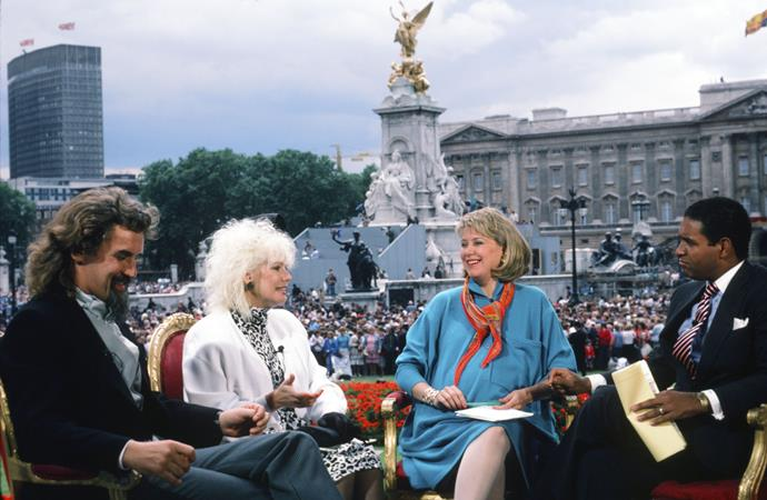 The wedding, which was watched by 500 million people globally, was the talk of the town. Here, Billy Connolly, actress Pamela Stephenson and *NBC News*' Jane Pauley and Bryant Gumbel discuss the festivities from outside Buckingham Palace for *TODAY*. Some iconic 80s fashion happening here!