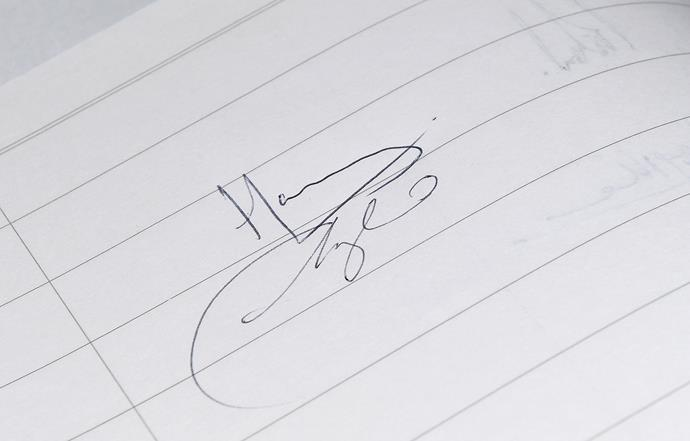 Meghan's signature was more scrawl-like in March this year.