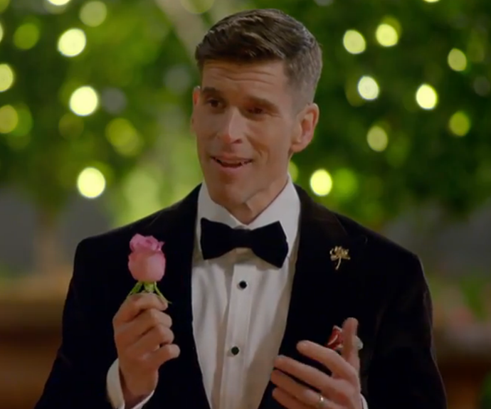 """Osher Gunsberg presents the """"Wild Rose"""" to the 2018 *Bachelorette* suitors. Image: Network Ten"""