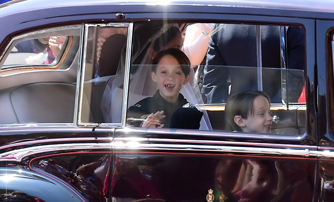 Duchess Meghan's page boy Brian Mulroney's excitable displays at the wedding had royal fans in fits. *(Image: Getty Images)*