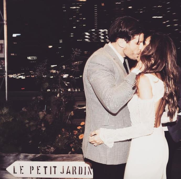 Sealed with a kiss at their engagement party. *(Image: @snezanawood Instagram)*