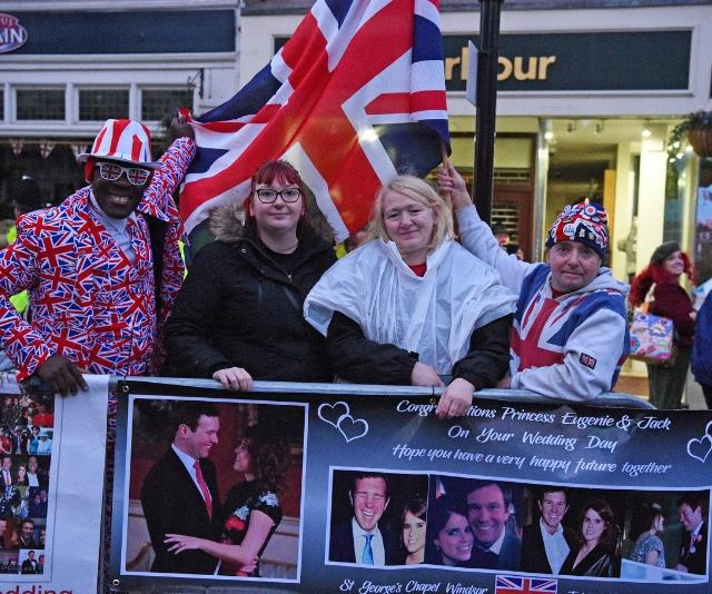 Crowds of happy revellers are lining the streets of Windsor to celebrate the royal wedding.
