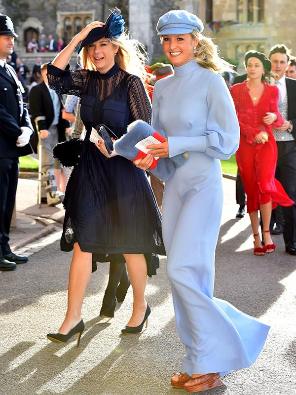 Prince Harry's ex girlfriend Chelsy Davy keeps a firm grip on her dark navy hat.  **WATCH IN THE NEXT SLIDE: Wedding guest loses her hat in the gale-force winds.**