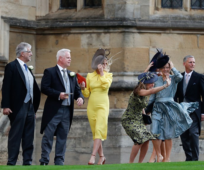 Guests arrived looking rather windswept at Eugenie's royal wedding.