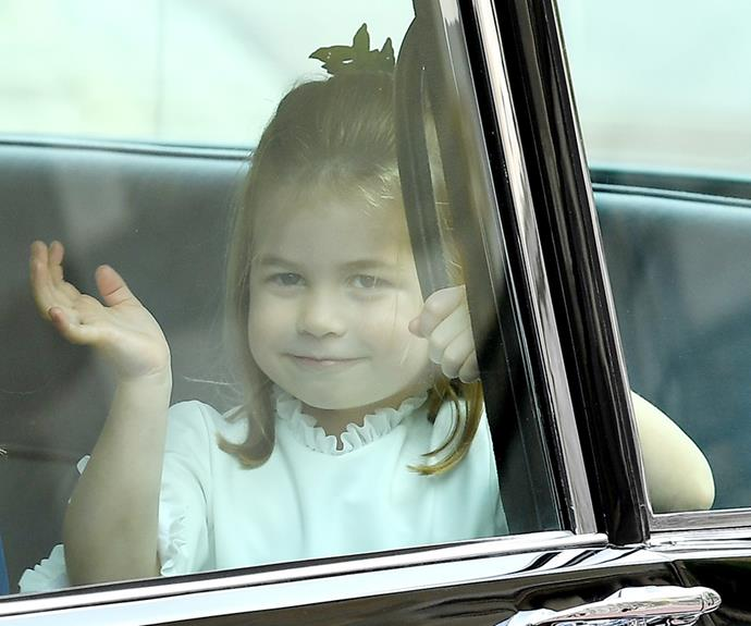 Ever the charmer, Princess Charlotte waved to the crowds.