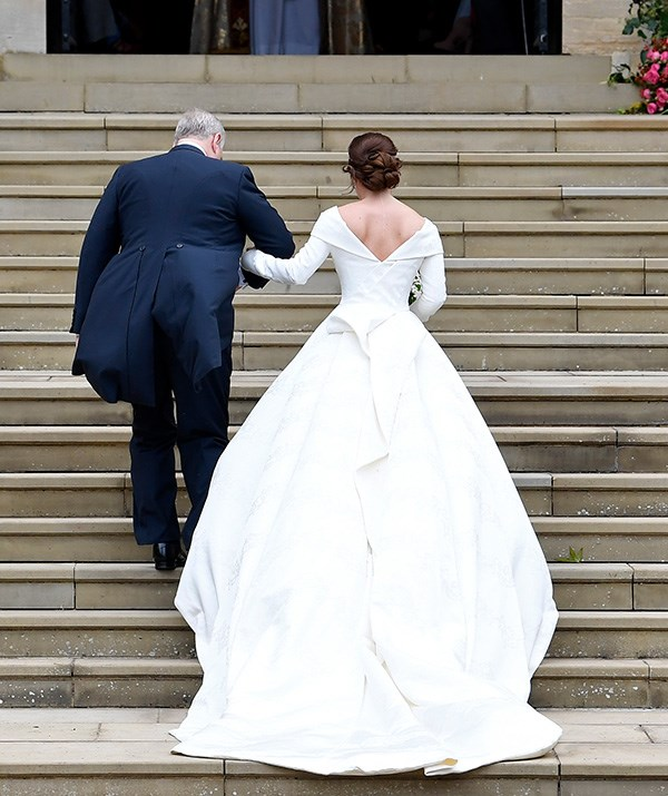 Eugenie opted for a stunning off-shoulder number with a flowing train and low back.