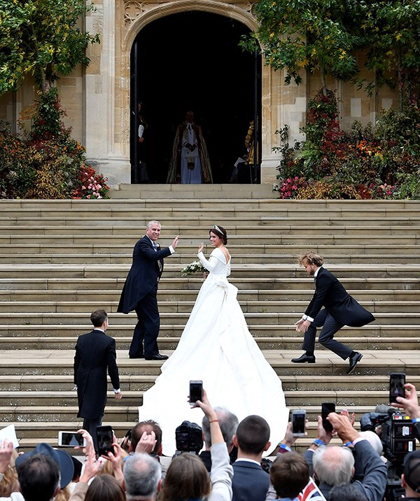 Princess Eugenie makes her way up the steps of St George's Chapel with her father Prince Andrew. *(Image: Getty)*