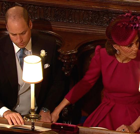 Breaking tradition: As they waited in their seats, William and Kate snuck in a rare PDA moment.