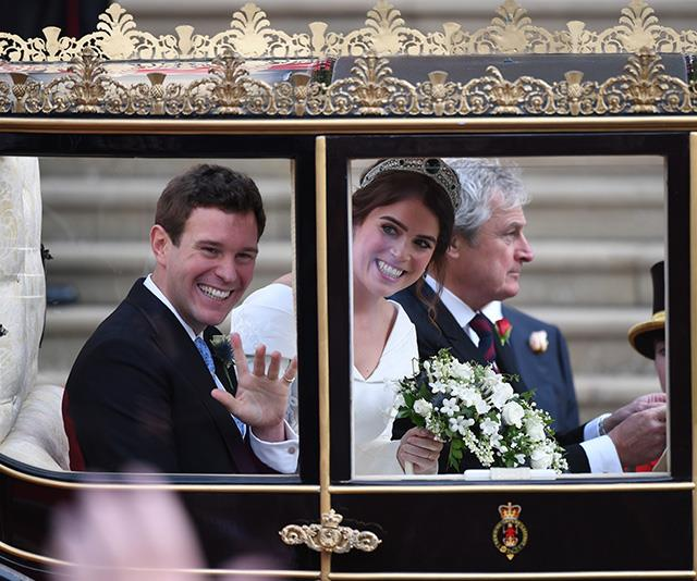 Princess Eugenie wore a stunning silver and emerald tiara that belonged to the Queen herself. *Image: AAP*