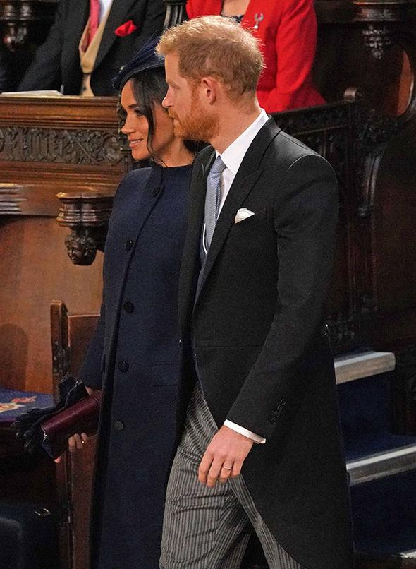 Meghan and Prince Harry find their seats at the service at Windsor castle. *(Image: Getty Images)*