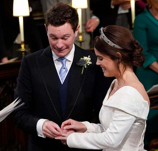 Jack struggles to put the ring on Princess Eugenie's finger. Source: Getty
