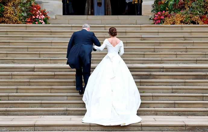 The Duke of York and Princess Eugenie walk up the stairs of Windsor Castle.
