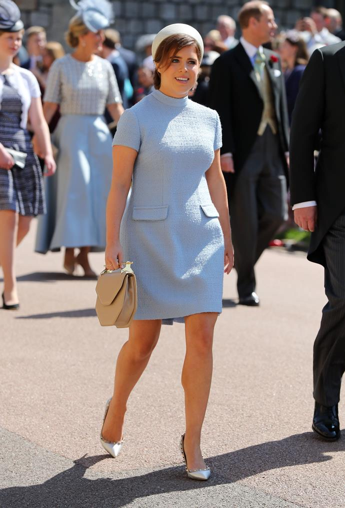 Princess Eugenie's dress for Harry and Meghan's wedding earlier this year was created by the same designer. *(Image: Getty Images)*